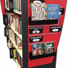 Shelving end panel with QWall and Signage